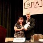 RSI's Emma Hartnett receiving SRA award